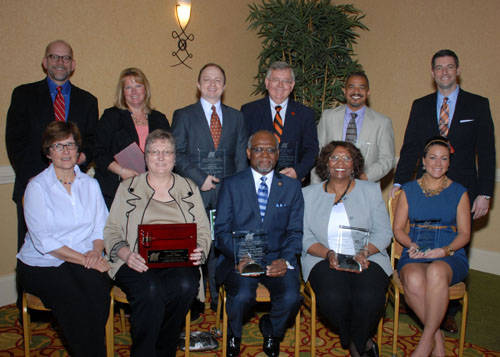Front row, left to right: First Row (left to right): Jane Reise, Citizens for the Advancement of Normandy; Sandy Weber, 2012 NCI Board Chair; County Executive Charlie A. Dooley, St. Louis County; Rosemary Johnson, Jennings School District; and Megan McMichael, World Wide Technology, Inc. Second Row (left to right): Dan Link, Citizens for the Advancement of Normandy; Kim Bakker, SSM Health Care – St. Louis; David Reif, National Retail Properties, Inc.; Dr. George Albin III, Ritenour School District; Councilman Dwayne T. James, City of Ferguson; and Joe McGettigan, World Wide Technology, Inc. Photograph courtesy of Kent Miller Photography